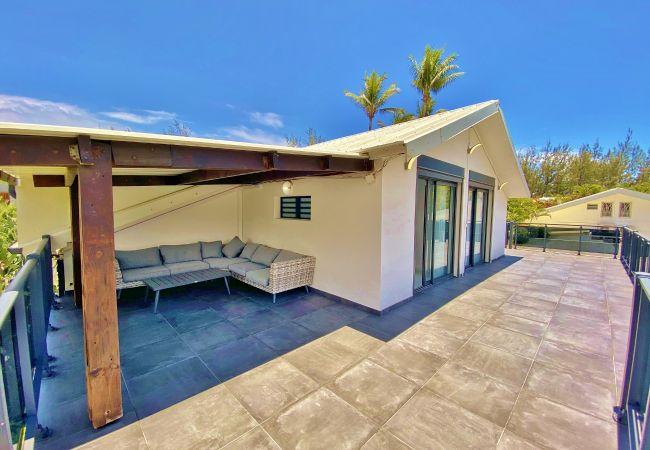 Maison de vacances avec terrasse et jardin tropical