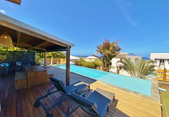Maison de vacances avec piscine à débordement (974)